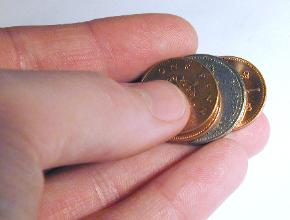Fingers holding coins